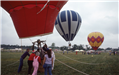 Image of 3 hot air balloons preparing for launch at the Festival of Flight