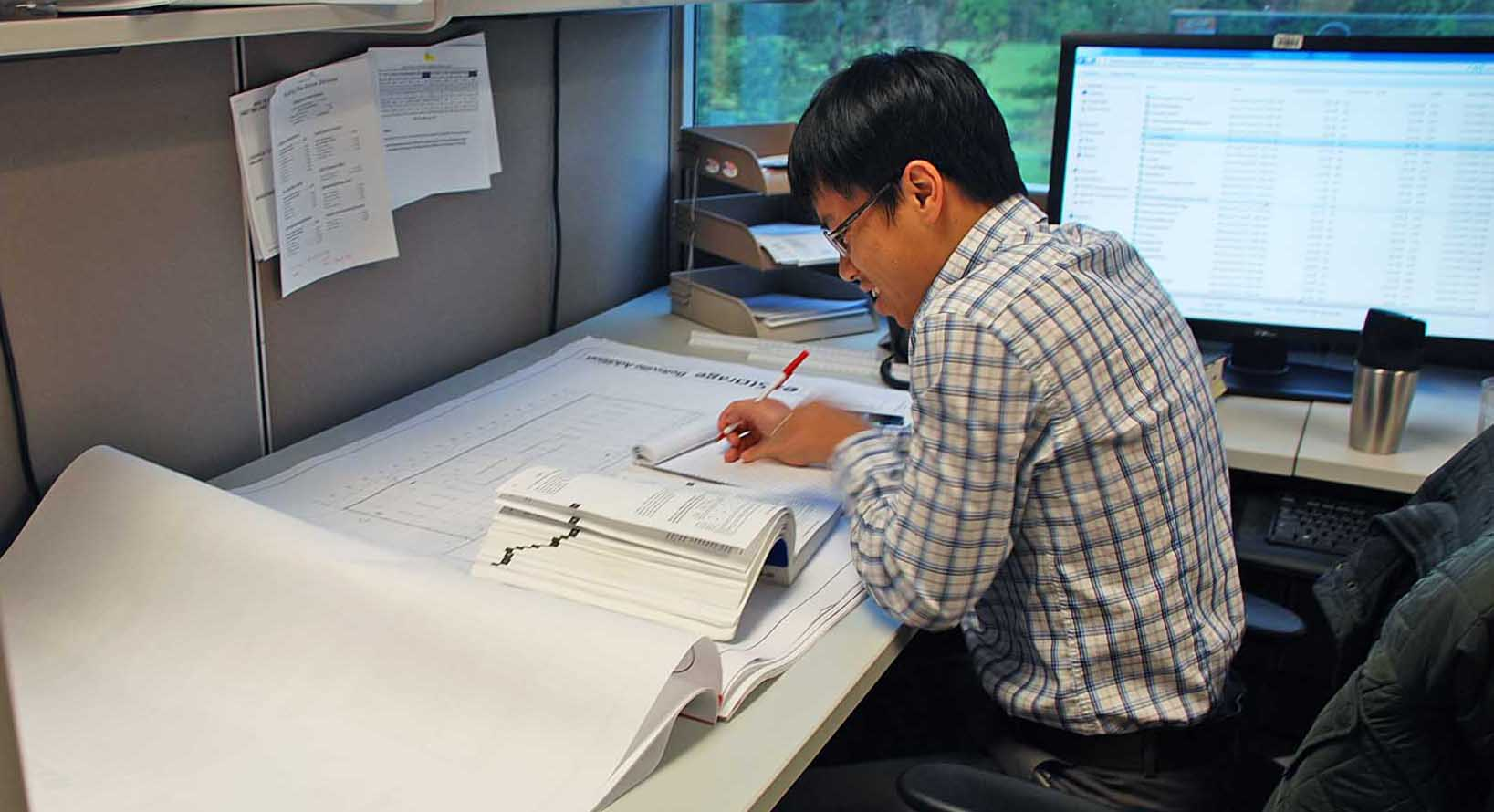 Building Plan Review employee reviewing plans