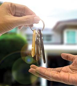Image of Handing Keys Over for a New House
