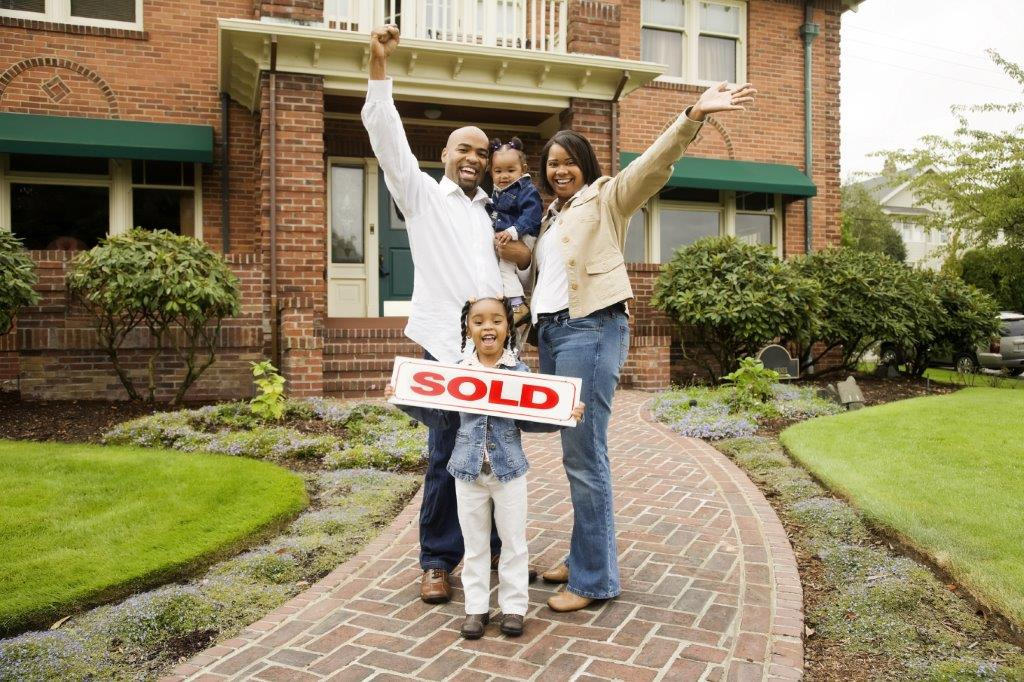 Family in front of recently sold house