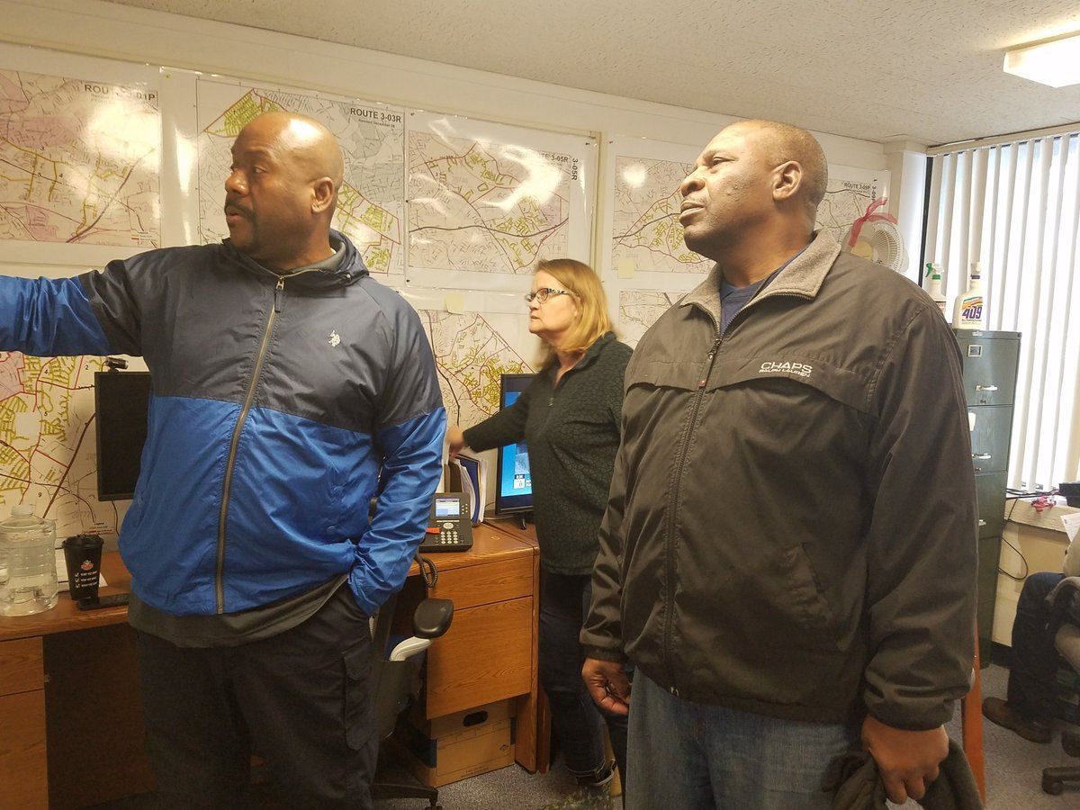 DPW&T Acting Director Terry Bellamy, and staff, read over snow maps during a snow event -- February