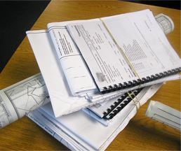 Stack of Permits on Desk