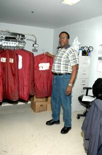 Property clerk receiving inmate clothing